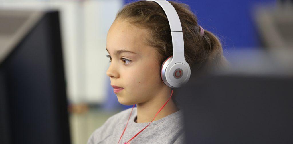 Girl coding at camp